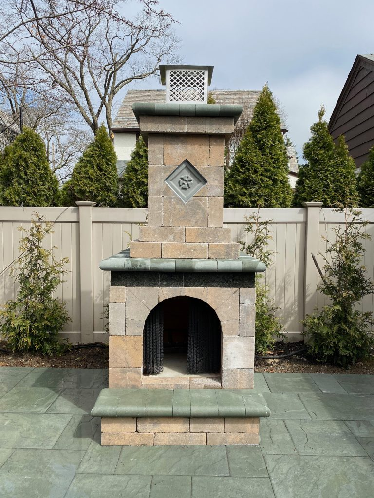 fireplace by ageless masonry in long island dream outdoor living space