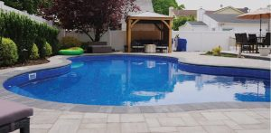 Poolscape patio ageless masonry in long island dream outdoor living space